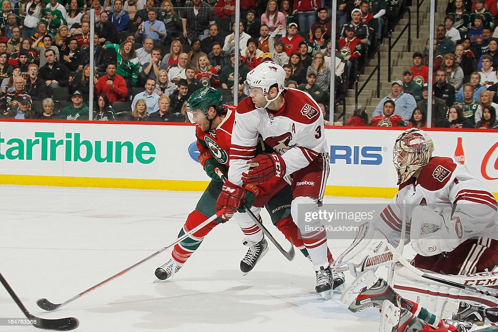 <a gi-track='captionPersonalityLinkClicked' href=/galleries/search?phrase=Matt+Cullen&family=editorial&specificpeople=536122 ng-click='$event.stopPropagation()'>Matt Cullen</a> #7 of the Minnesota Wild fights for position with <a gi-track='captionPersonalityLinkClicked' href=/galleries/search?phrase=Keith+Yandle&family=editorial&specificpeople=606912 ng-click='$event.stopPropagation()'>Keith Yandle</a> #3 and goalie <a gi-track='captionPersonalityLinkClicked' href=/galleries/search?phrase=Jason+LaBarbera&family=editorial&specificpeople=240674 ng-click='$event.stopPropagation()'>Jason LaBarbera</a> #1 of the Phoenix Coyotes defending during the game on March 27, 2013 at the Xcel Energy Center in Saint Paul, Minnesota.