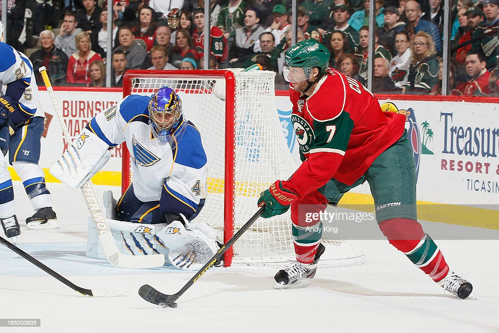 <a gi-track='captionPersonalityLinkClicked' href=/galleries/search?phrase=Matt+Cullen&family=editorial&specificpeople=536122 ng-click='$event.stopPropagation()'>Matt Cullen</a> #7 of the Minnesota Wild handles the puck while goalie <a gi-track='captionPersonalityLinkClicked' href=/galleries/search?phrase=Jaroslav+Halak&family=editorial&specificpeople=2285591 ng-click='$event.stopPropagation()'>Jaroslav Halak</a> #41 of the St. Louis Blues defends during the game on April 1, 2013 at the Xcel Energy Center in Saint Paul, Minnesota.