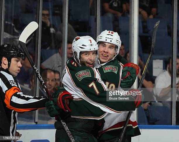 Matt Cullen of the Minnesota Wild scores at 113 of the third period against the New York Islanders and is joined by Brett Bulmer at Nassau Veterans...