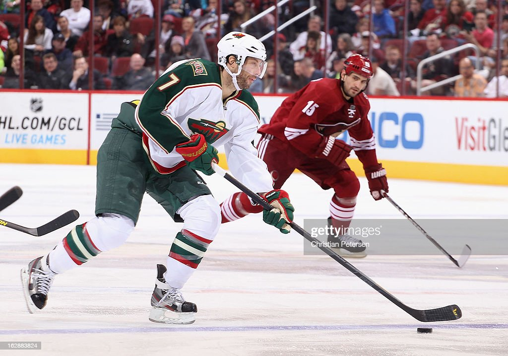 <a gi-track='captionPersonalityLinkClicked' href=/galleries/search?phrase=Matt+Cullen&family=editorial&specificpeople=536122 ng-click='$event.stopPropagation()'>Matt Cullen</a> #7 of the Minnesota Wild skates with the puck past <a gi-track='captionPersonalityLinkClicked' href=/galleries/search?phrase=Boyd+Gordon&family=editorial&specificpeople=209395 ng-click='$event.stopPropagation()'>Boyd Gordon</a> #15 of the Phoenix Coyotes during the NHL game at Jobing.com Arena on February 28, 2013 in Glendale, Arizona. The Wild defeated the Coyotes 4-3.