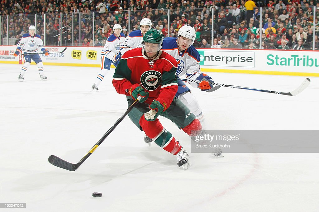 <a gi-track='captionPersonalityLinkClicked' href=/galleries/search?phrase=Matt+Cullen&family=editorial&specificpeople=536122 ng-click='$event.stopPropagation()'>Matt Cullen</a> #7 of the Minnesota Wild skates with the puck while Ladislav Smid #5 of the Edmonton Oilers defends during the game on March 3, 2013 at the Xcel Energy Center in Saint Paul, Minnesota.