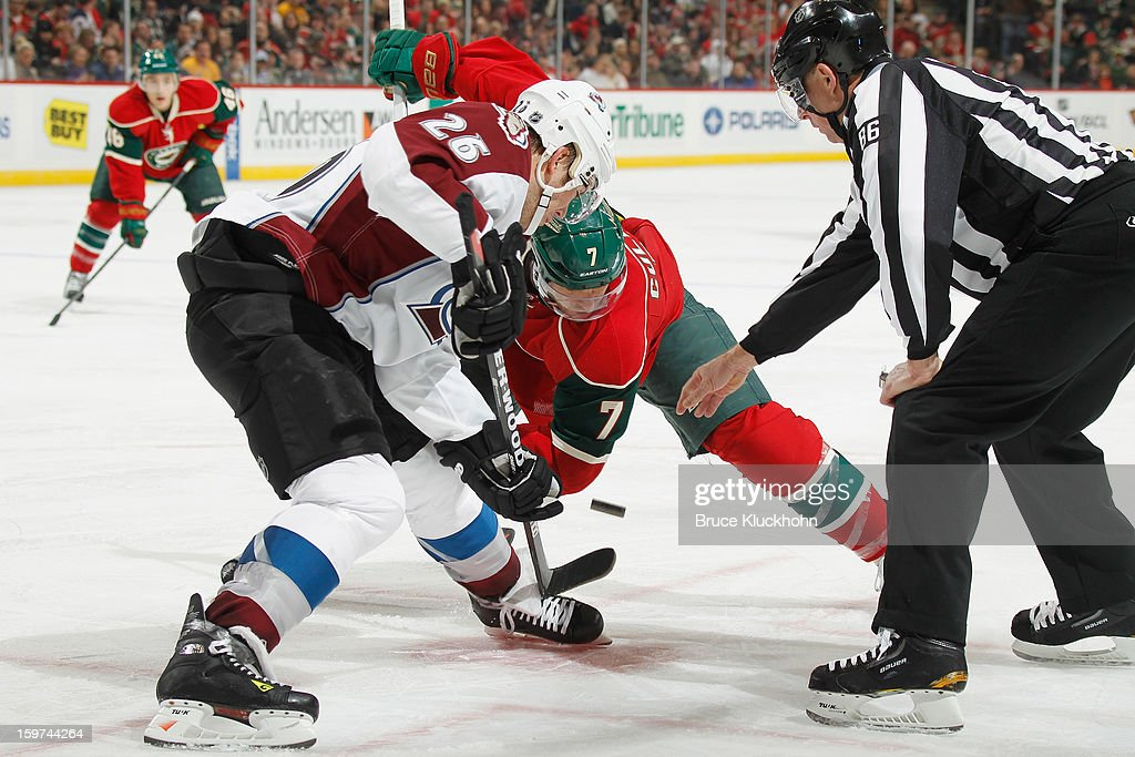 Matt Cullen #7 of the Minnesota Wild takes a face-off against Paul Stastny #26 of the Colorado Avalanche during the game on January 19, 2013 at the Xcel Energy Center in Saint Paul, Minnesota.