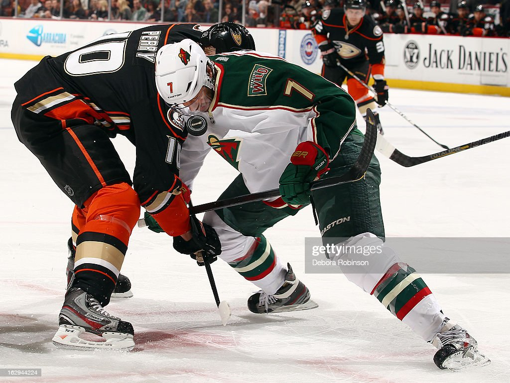 Matt Cullen #7 of the Minnesota Wild takes the faceoff against Corey Perry #10 of the Anaheim Ducks on March 1, 2013 at Honda Center in Anaheim, California.