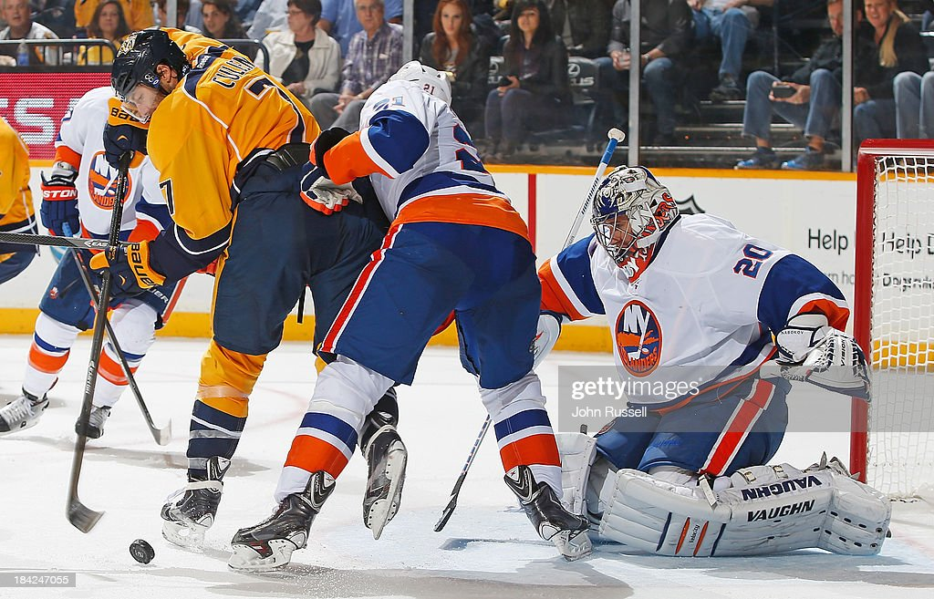 <a gi-track='captionPersonalityLinkClicked' href=/galleries/search?phrase=Matt+Cullen&family=editorial&specificpeople=536122 ng-click='$event.stopPropagation()'>Matt Cullen</a> #7 of the Nashville Predators backhands a shot against <a gi-track='captionPersonalityLinkClicked' href=/galleries/search?phrase=Evgeni+Nabokov&family=editorial&specificpeople=171380 ng-click='$event.stopPropagation()'>Evgeni Nabokov</a> #20 of the New York Islanders at Bridgestone Arena on October 12, 2013 in Nashville, Tennessee.