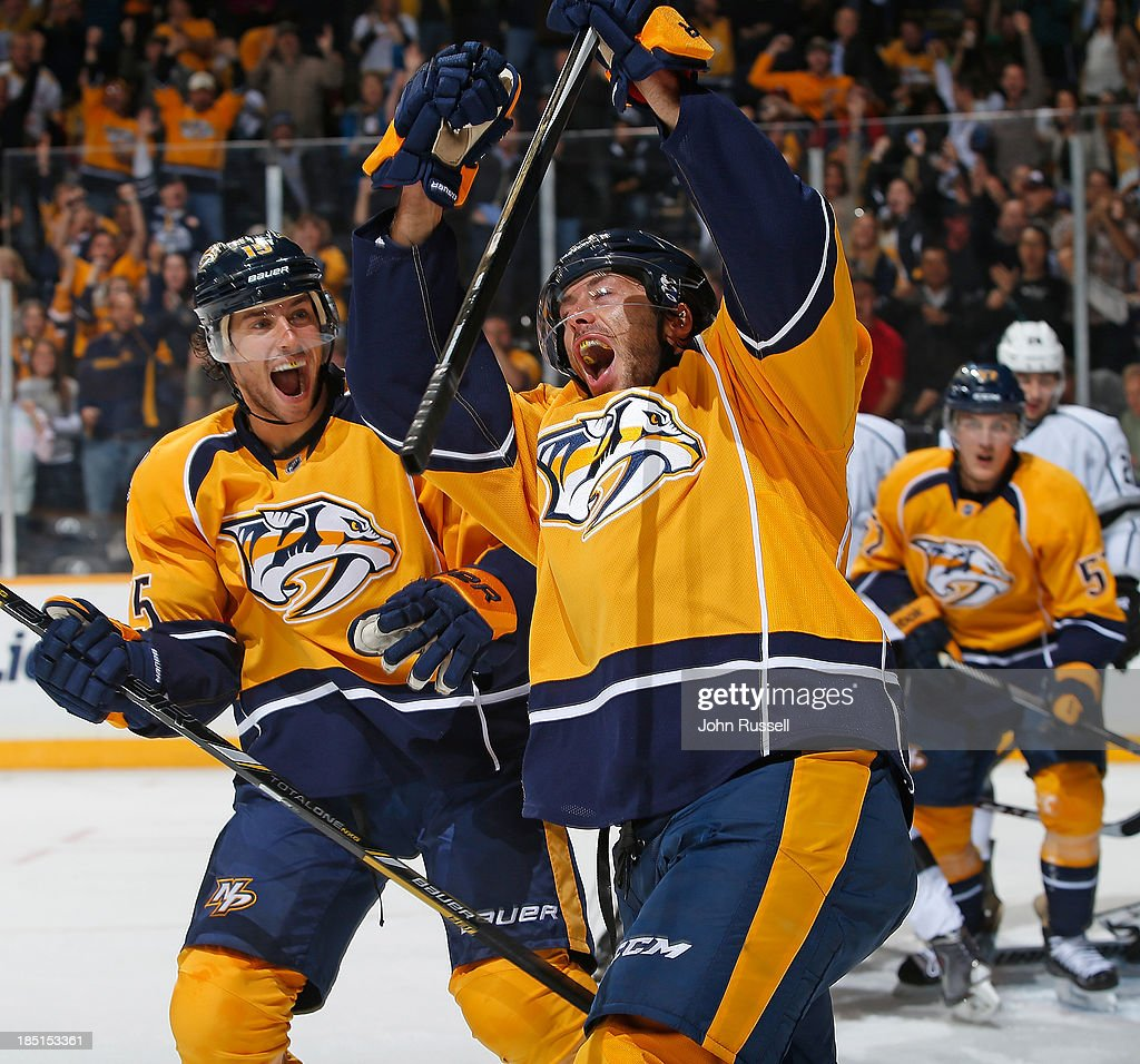 Matt Cullen #7 of the Nashville Predators celebrates his goal with Craig Smith #15 against the Los Angeles Kings at Bridgestone Arena on October 17, 2013 in Nashville, Tennessee.