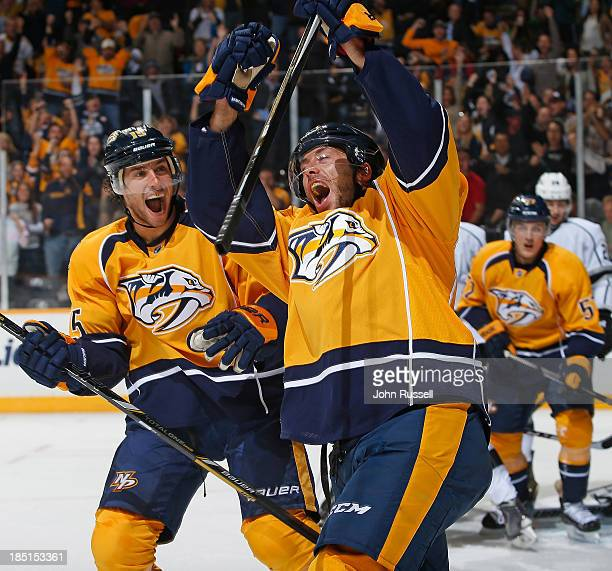 Matt Cullen of the Nashville Predators celebrates his goal with Craig Smith against the Los Angeles Kings at Bridgestone Arena on October 17 2013 in...
