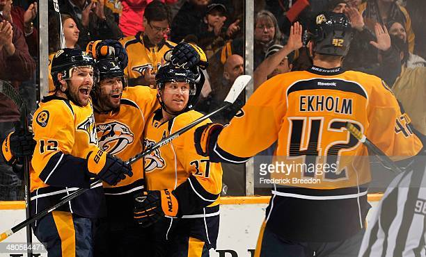 Matt Cullen of the Nashville Predators is congratulated by teammates Mike Fisher Patric Hornqvist and Mattias Ekholm on scoring a goal against the...