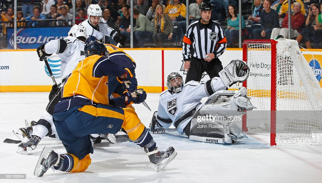 <a gi-track='captionPersonalityLinkClicked' href=/galleries/search?phrase=Matt+Cullen&family=editorial&specificpeople=536122 ng-click='$event.stopPropagation()'>Matt Cullen</a> #7 of the Nashville Predators puts the puck in the net against <a gi-track='captionPersonalityLinkClicked' href=/galleries/search?phrase=Jonathan+Quick&family=editorial&specificpeople=2271852 ng-click='$event.stopPropagation()'>Jonathan Quick</a> #32 of the Los Angeles Kings at Bridgestone Arena on October 17, 2013 in Nashville, Tennessee.
