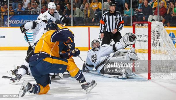 Matt Cullen of the Nashville Predators puts the puck in the net against Jonathan Quick of the Los Angeles Kings at Bridgestone Arena on October 17...