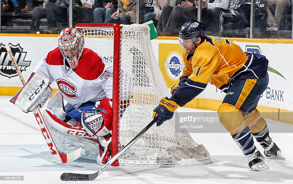 <a gi-track='captionPersonalityLinkClicked' href=/galleries/search?phrase=Matt+Cullen&family=editorial&specificpeople=536122 ng-click='$event.stopPropagation()'>Matt Cullen</a> #7 of the Nashville Predators puts the puck on net against <a gi-track='captionPersonalityLinkClicked' href=/galleries/search?phrase=Carey+Price&family=editorial&specificpeople=2222083 ng-click='$event.stopPropagation()'>Carey Price</a> #31 of the Montreal Canadiens at Bridgestone Arena on December 21, 2013 in Nashville, Tennessee.