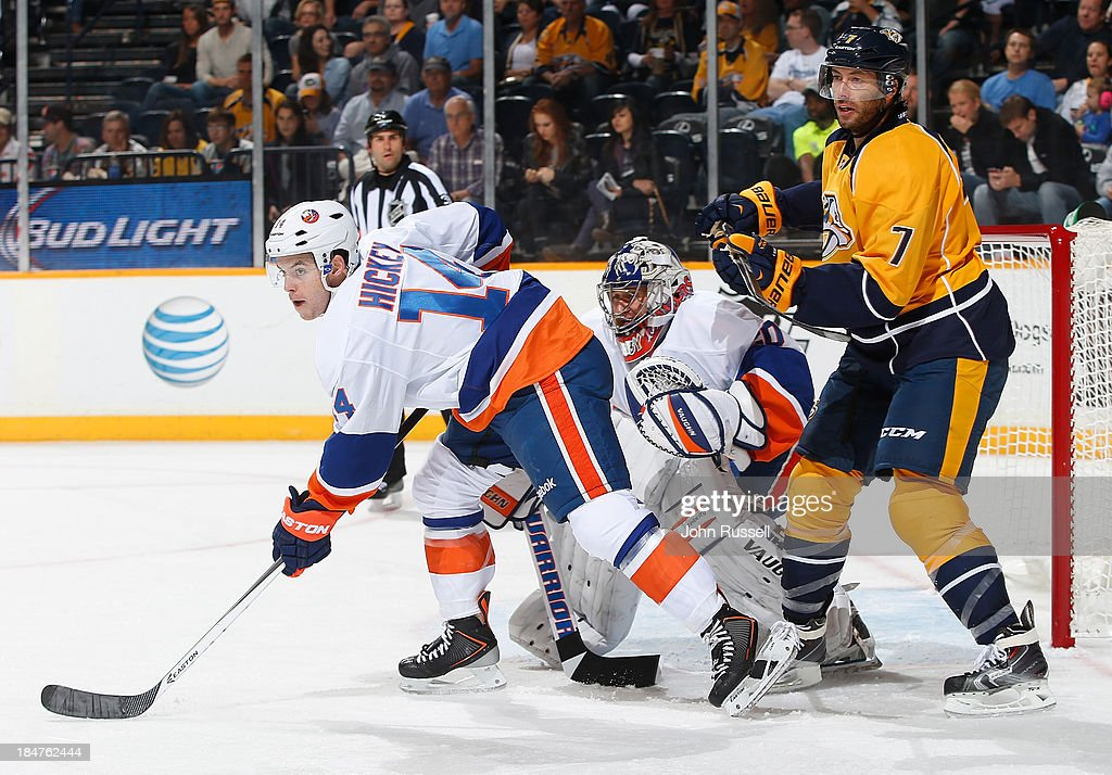<a gi-track='captionPersonalityLinkClicked' href=/galleries/search?phrase=Matt+Cullen&family=editorial&specificpeople=536122 ng-click='$event.stopPropagation()'>Matt Cullen</a> #7 of the Nashville Predators skates against Thomas Hickey #14 and <a gi-track='captionPersonalityLinkClicked' href=/galleries/search?phrase=Evgeni+Nabokov&family=editorial&specificpeople=171380 ng-click='$event.stopPropagation()'>Evgeni Nabokov</a> #20 of the New York Islanders at Bridgestone Arena on October 12, 2013 in Nashville, Tennessee.