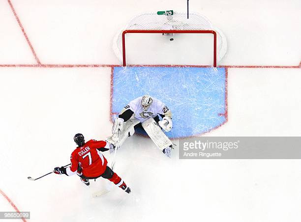 Matt Cullen of the Ottawa Senators shoots the puck in the back of the net behind MarcAndre Fleury of the Pittsburgh Penguins for a first period goal...