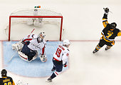 Matt Cullen of the Pittsburgh Penguins celebrates his goal in front of Braden Holtby and Nicklas Backstrom of the Washington Capitals in Game Four of...