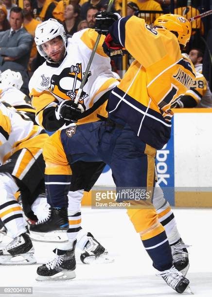 Matt Cullen of the Pittsburgh Penguins collides with Calle Jarnkrok of the Nashville Predators during the first period of Game Three of the 2017 NHL...