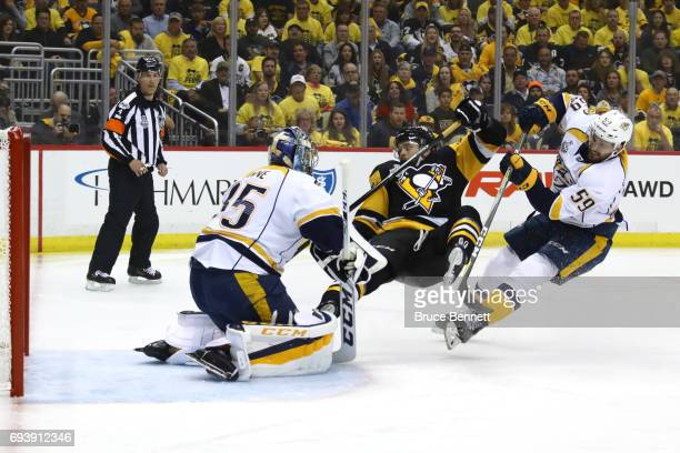 Matt Cullen of the Pittsburgh Penguins collides with Pekka Rinne and Roman Josi of the Nashville Predators in the first period in Game Five of the...