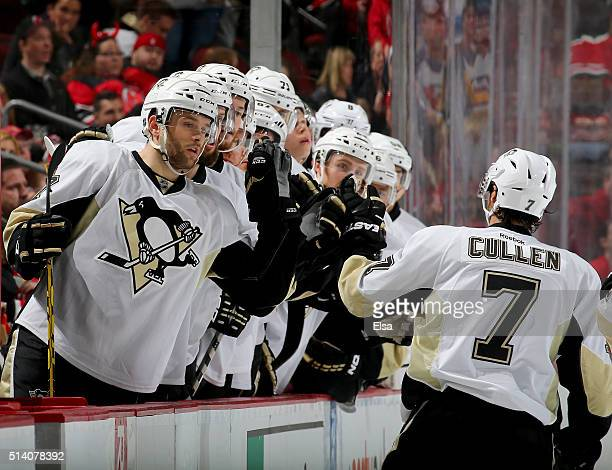 Matt Cullen of the Pittsburgh Penguins is congratulated by teammates on the bench after he scored a goal in the first period against the New Jersey...