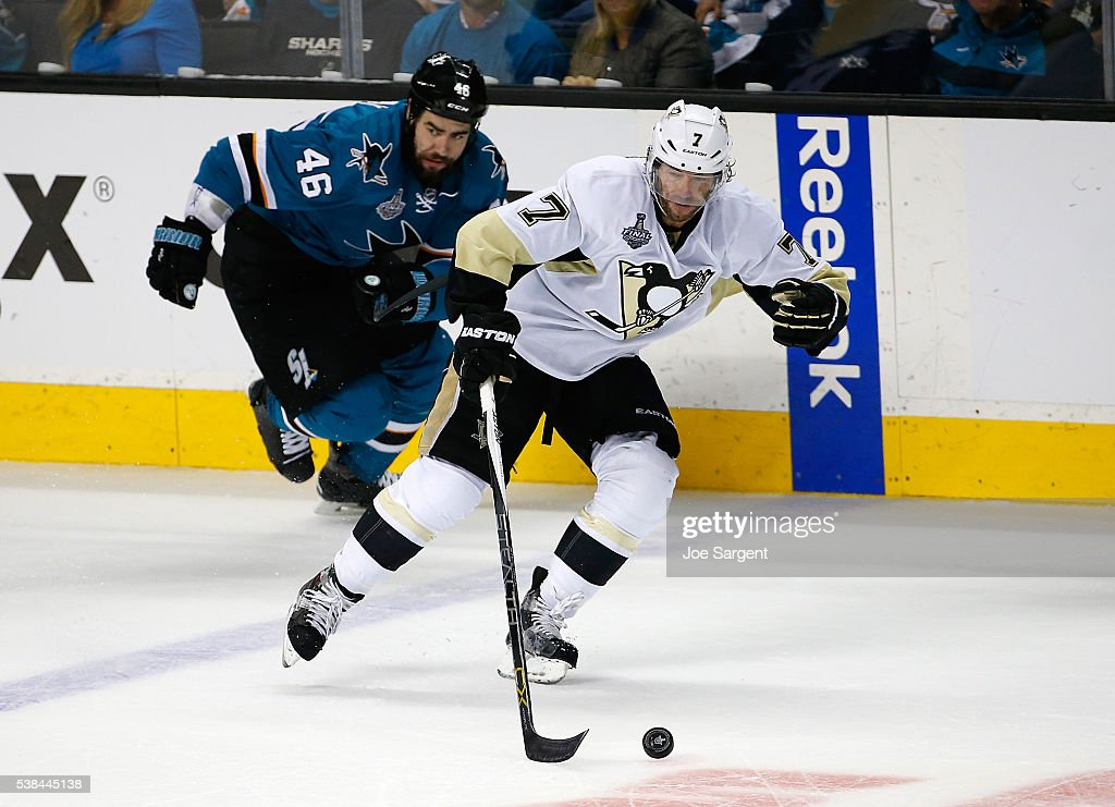Matt Cullen #7 of the Pittsburgh Penguins moves the puck up ice in front of Roman Polak #46 of the San Jose Sharks during Game Four of the 2016 NHL Stanley Cup Final at SAP Center on June 6, 2016 in San Jose, California.