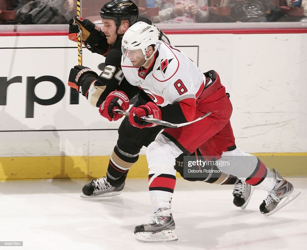 Matt Cullenn of the Carolina Hurricanes races alongside the boards against James Wisniewski of the Anaheim Ducks during the game on November 25 2009...