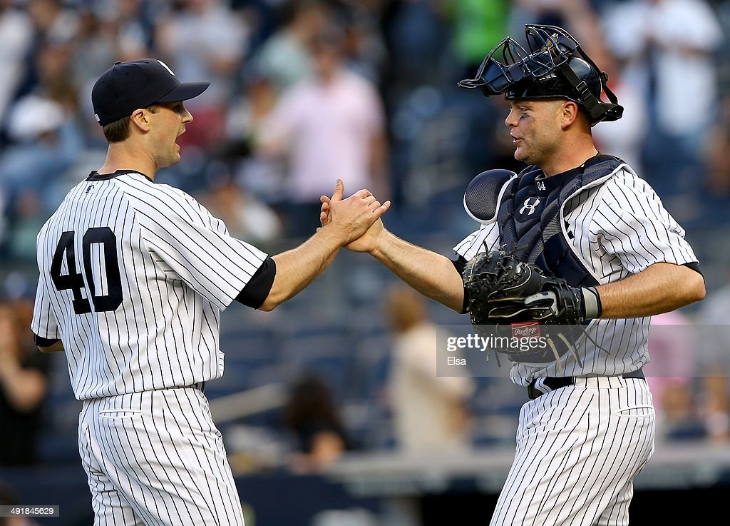 Matt Daley #40 of the New York Yankees and Brian McCann #34 of the New York Yankees celebrate the win over the Pittsburgh Pirates on May 17, 2014 at Yankee Stadium in the Bronx borough of New York City.The New York Yankees defeated the Pittsburgh Pirates 7-1.