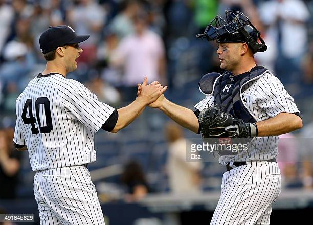 Matt Daley of the New York Yankees and Brian McCann of the New York Yankees celebrate the win over the Pittsburgh Pirates on May 17 2014 at Yankee...