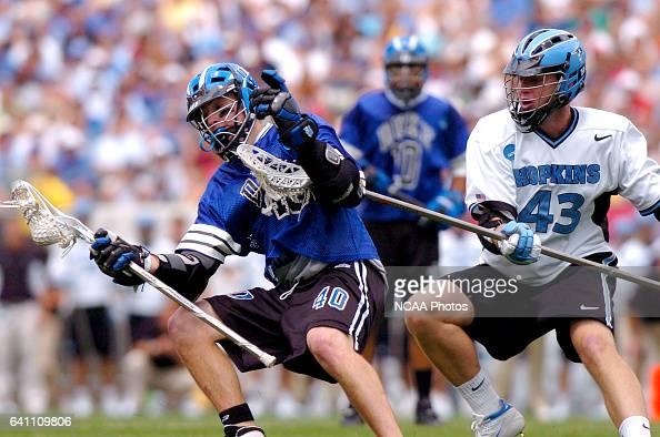 Matt Danowski of Duke changes directions on Johns Hopkins' Chris Watson during the Division I Men's Lacrosse Championship help at Lincoln Financial...