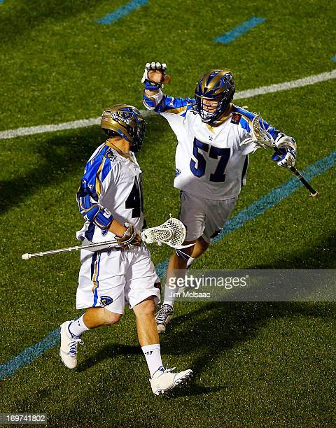 Matt Danowski of the Charlotte Hounds celebrates his second goal against the New York Lizards with teammate Peet Poillon during their Major League...