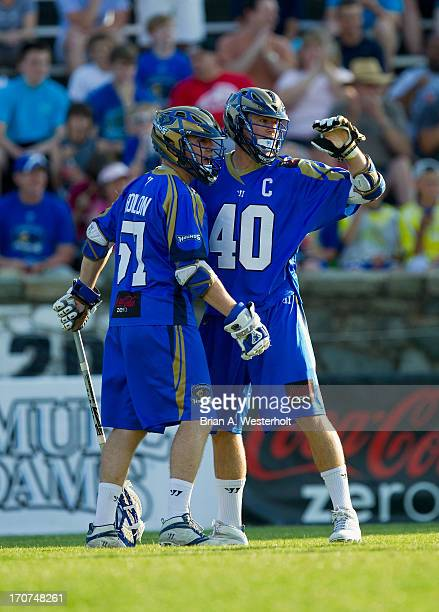 Matt Danowski of the Charlotte Hounds celebrates with teammate Peet Poillon after scoring a goal against the Boston Cannons at American Legion...