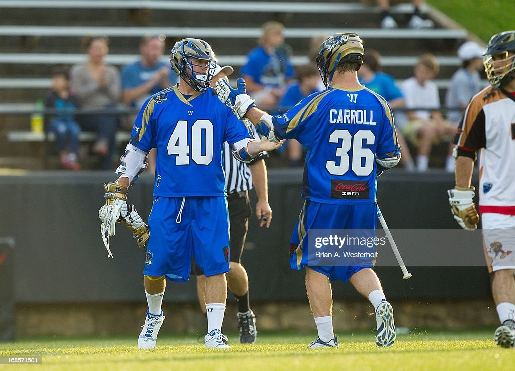 Matt Danowski #40 of the Charlotte Hounds is congratulated by teamate Brian Carroll #36 after scoring a goal against the Rochester Rattlers at American Legion Memorial Stadium on May 11, 2013 in Charlotte, North Carolina.