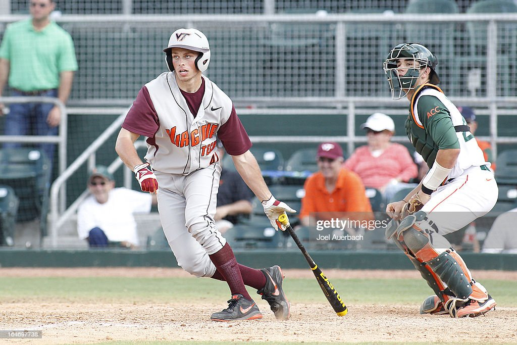 Matt Dauby #41 of the Virginia Tech Hokies drives in the final run of the game against the Miami Hurricanes on March 24, 2013 at Alex Rodriguez Park at Mark Light Field in Coral Gables, Florida. Virginia Tech defeated Miami 8-5 in 10 innings.