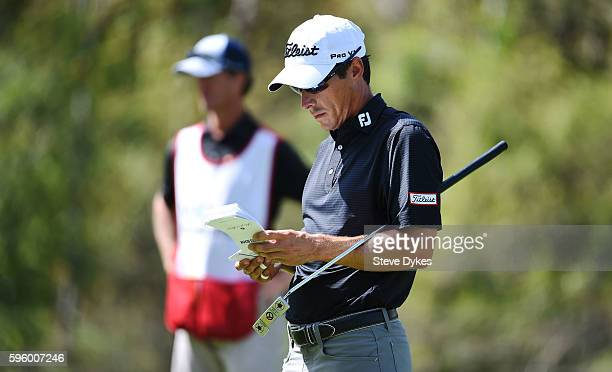 Matt Davidson checks his book on the 18th green during the second round of the WinCo Foods Portland Open on August 26 2016 in North Plains Oregon...