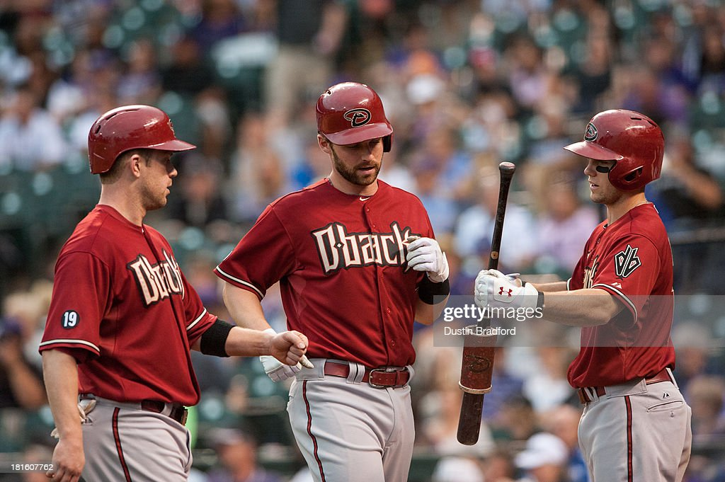 <a gi-track='captionPersonalityLinkClicked' href=/galleries/search?phrase=Matt+Davidson+-+Baseball+Player&family=editorial&specificpeople=15052724 ng-click='$event.stopPropagation()'>Matt Davidson</a> #24 of the Arizona Diamondbacks celebrates a three-run ninth inning home run with teammates <a gi-track='captionPersonalityLinkClicked' href=/galleries/search?phrase=Aaron+Hill+-+Baseball+Player&family=editorial&specificpeople=239242 ng-click='$event.stopPropagation()'>Aaron Hill</a> #2 and Chris Owings #16 during a game against the Colorado Rockies at Coors Field on September 22, 2013 in Denver, Colorado.