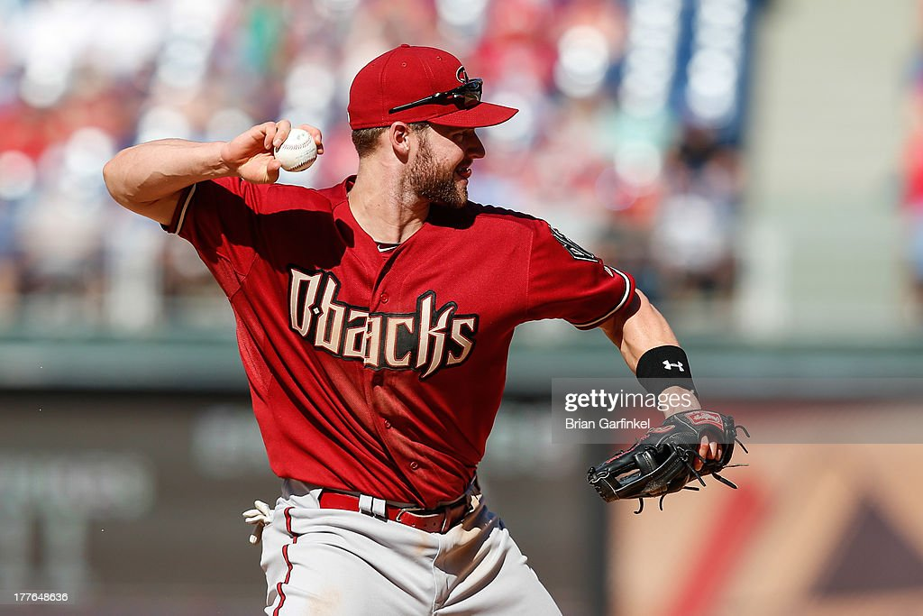 <a gi-track='captionPersonalityLinkClicked' href=/galleries/search?phrase=Matt+Davidson+-+Baseball+Player&family=editorial&specificpeople=15052724 ng-click='$event.stopPropagation()'>Matt Davidson</a> #24 of the Arizona Diamondbacks throws the ball to first in the eighth inning of the game against the Philadelphia Phillies at Citizens Bank Park on August 25, 2013 in Philadelphia, Pennsylvania. The Phillies won 9-5.