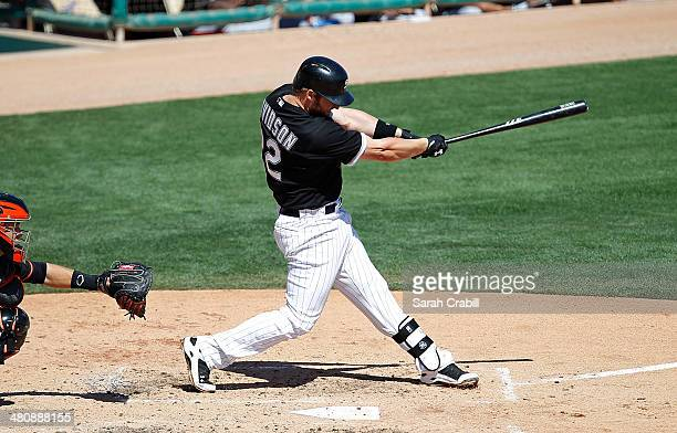 Matt Davidson of the Chicago White Sox bats during a spring training game against the San Francisco Giants at Camelback Ranch on March 22 2014 in...