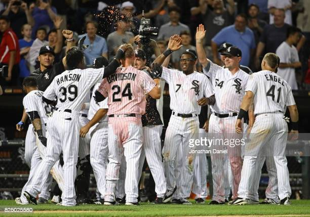 Matt Davidson of the Chicago White Sox celebrates getting the gamewinning hit in the 9th inning with teammates including Alen Hanson Tim Anderson snd...