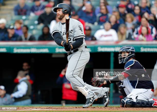 Matt Davidson of the Chicago White Sox hits an RBI single against the Cleveland Indians in the second inning at Progressive Field on April 12 2017 in...