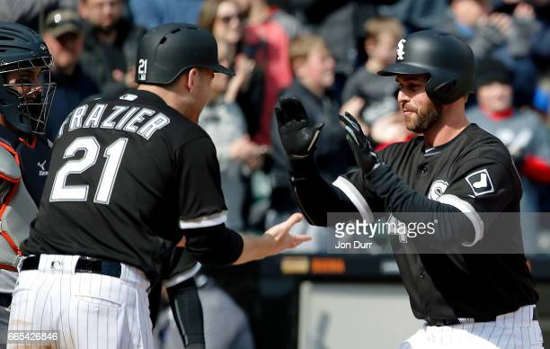 Matt Davidson of the Chicago White Sox is congratulated by Todd Frazier after hitting a three run home run against the Detroit Tigers during the...