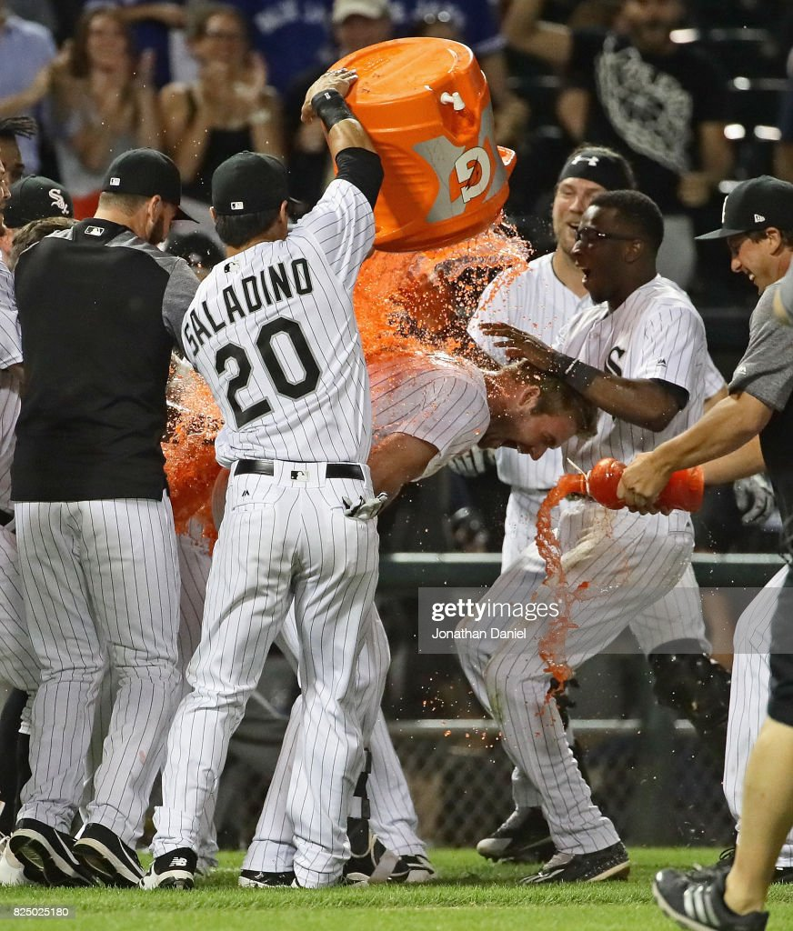 Matt Davidson #24 of the Chicago White Sox is doused with Gatorade by teammate Tyler Saladino #20 after getting the game-winning hit, a run scoring single in the 9th inning, against the Toronto Blue Jays at Guaranteed Rate Field on July 31, 2017 in Chicago, Illinois. The White Sox defeated the Blue Jays 7-6.