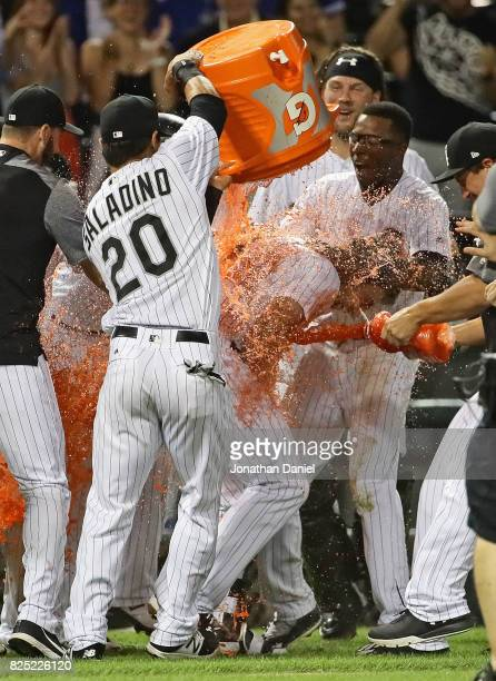 Matt Davidson of the Chicago White Sox is doused with Gatorade by teammate Tyler Saladino after getting the gamewinning hit a run scoring single in...