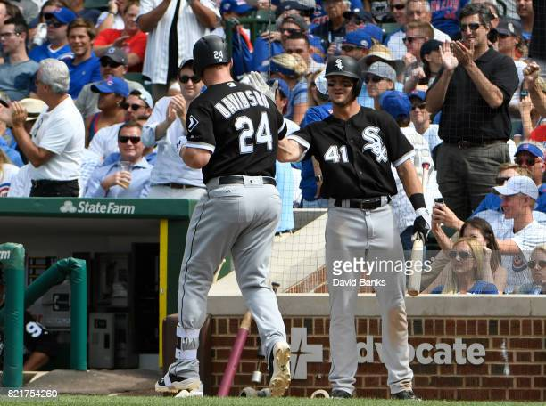 Matt Davidson of the Chicago White Sox is greeted by Adam Engel after hitting a home run against the Chicago Cubs during the eighth inning on July 24...