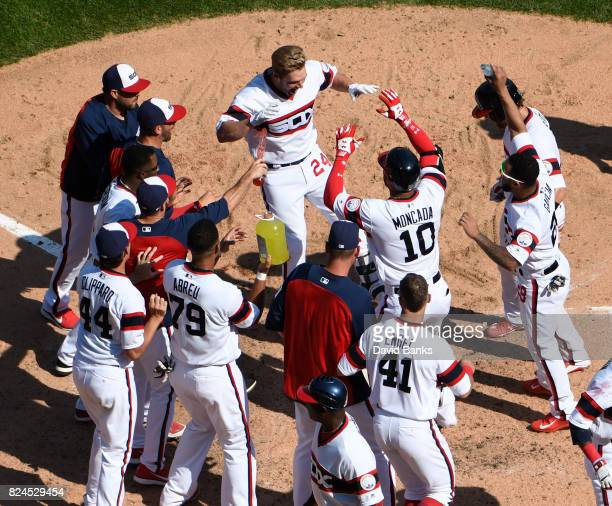 Matt Davidson of the Chicago White Sox is greeted by his teammates after hitting a game winning tworun homer against the Cleveland Indians on July 30...