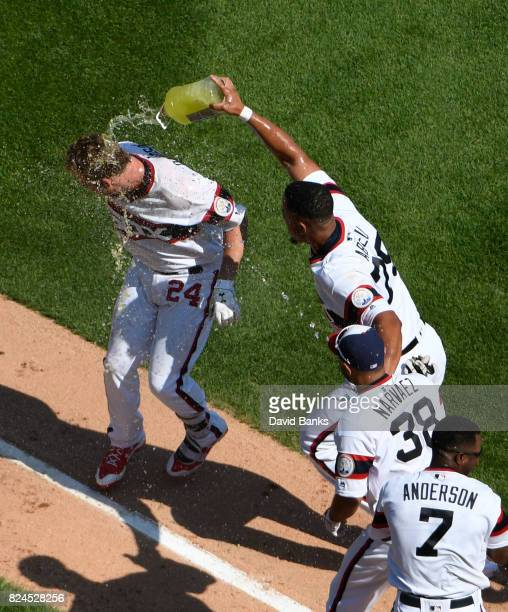 Matt Davidson of the Chicago White Sox is greeted by Jose Abreu of the after hitting a game winning tworun homer against the Cleveland Indians on...