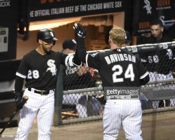 Matt Davidson of the Chicago White Sox is greeted by Leury Garcia after hitting a home run against the Kansas City Royals during the second inning on...