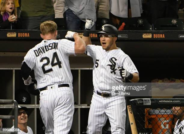 Matt Davidson of the Chicago White Sox is greeted by Yolmer Sanchez after hitting a home run against the Baltimore Orioles during the second inning...