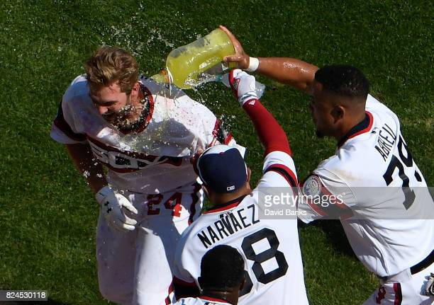 Matt Davidson of the Chicago White Sox is is sprayed with sports drink by Jose Abreu and Omar Narvaez after hitting a game winning tworun homer...