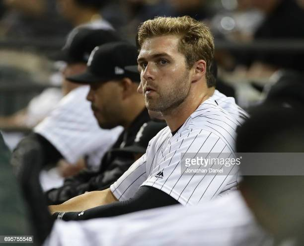 Matt Davidson of the Chicago White Sox watches from the bench after hitting his first career grand slam home run against the Baltimore Orioles at...