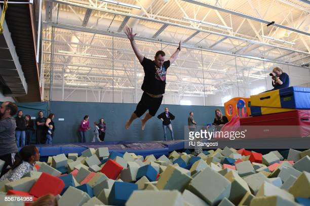 Matt Davis who is currently in the Air Force jumps into the foam pit at the Grand Park Community Recreation Center on October 2 2017 in Fraser...