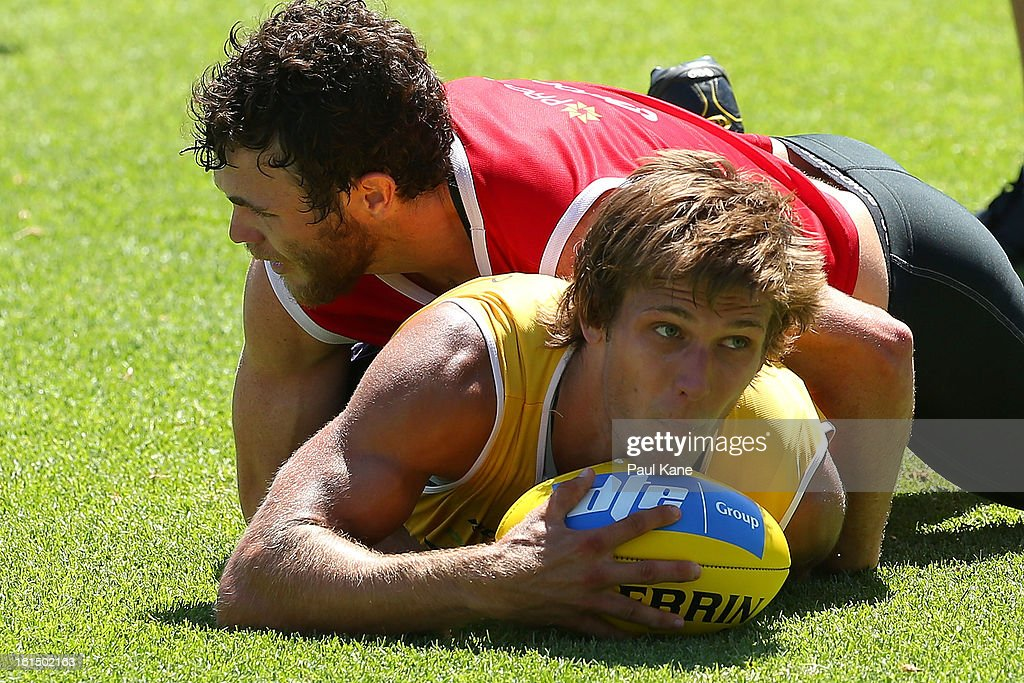 Matt De Boer of the Dockers gets tackled by Hayden Ballantyne during a Fremantle Dockers AFL training session at Fremantle Oval on February 12, 2013 in Fremantle, Australia.
