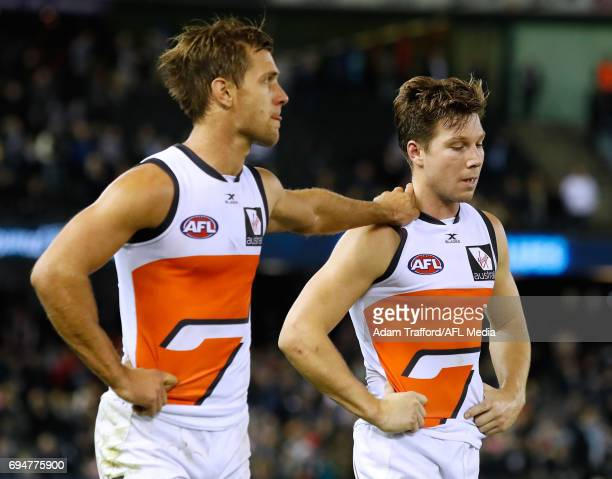 Matt de Boer of the Giants consoles Toby Greene of the Giants during the 2017 AFL round 12 match between the Carlton Blues and the GWS Giants at...