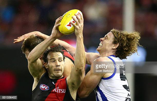 Matt Dea of the Bombers and Ben Brown of the Kangaroos compete for the ball during the round eight AFL match between the Essendon Bombers and the...