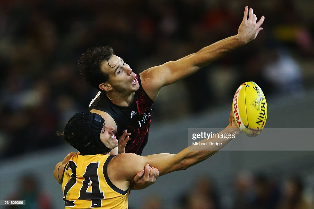 Matt Dea of the Bombers competes for the ball over Ben Griffiths of the Tigers during the round 10 AFL match between the Essendon Bombers and the Richmond Tigers at Melbourne Cricket Ground on May 28, 2016 in Melbourne, Australia.